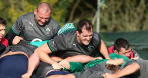 Dan Tuohy (left) and Devin Toner (centre) hard at work at Ireland's squad session at Carton House in Co Kildare. Photograph: Billy Stickland/Inpho