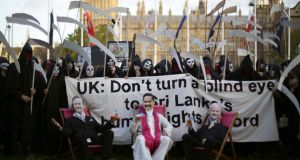 Amnesty supporters dressed as grim reapers, British prime minister David Cameron, Sri Lankan president Mahinda Rajapaksa and British foreign secretary William Hague, gather in Parliament Square, central London, last weekend to protest the British  government's endorsement of Sri Lanka at the  impending Commonwealth Heads of Government Meeting in Colombo. Photograph: Yui Mok/PA Wire