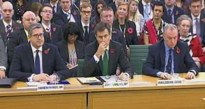 From left: the director general of security service MI5, Andrew Parker; the chief of the Secret Intelligence Service (MI6), John Sawers; and the director of GCHQ, Iain Lobban, at the first parliamentary Intelligence and Security Committee in London yesterday. Photograph: PA Wire