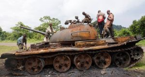 Congolese children play on a military tank, abandoned by the M23 rebel fighters who surrendered in Kibumba, near the eastern town of Goma on Wednesday.  Photograph: Reuters/Kenny Katombe