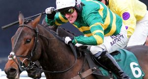 Tony McCoy riding Mountain Tunes to victory in  the Weatherbys Novices' Hurdle Race at Towcester Racecourse, Northamptonshire. Photograh: Rui Vieira/PA Wire