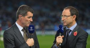 Republic of Ireland manager Martin O'Neill (R) - who is from Derry - and his assistant Roy Keane - a Corkman -  commentating for ITV on  the UEFA Champions League match between Real Sociedad and Manchester United in San Sebastian, Spain, earlier this week. Photograph:  Mike Hewitt/Getty Images