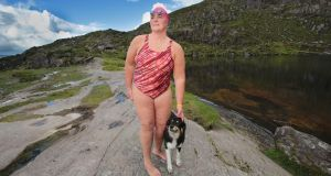 Swimmer Nuala Moore with her dog LG. Photograph: Valerie O'Sullivan