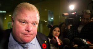 "Mayor Ford makes a statement to the media outside his office at Toronto's city hall this week. A new video surfaced showing Ford in a rage, using threatening words including ""kill"" and ""murder."" Ford said he was ""extremely, extremely inebriated"" in the video. Photograph: AP"