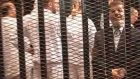 Ousted Egyptian president Mohamed Morsi stands in a cage in a courthouse in Cairo during his trial. Photograph: Egyptian interior ministry/via Reuters