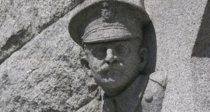 One of the stone heads of Dublin Metropolitan policemen on Pearse Street Garda station, Dublin