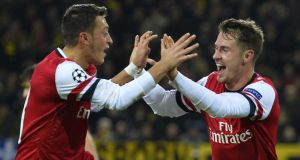 Arsenal's Aaron Ramsey after scoring  Arsenal's goal against Borussia Dortmund with midfielder Mesut Ozil.