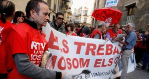 Employees of public broadcaster Radio Television Valenciana protest on November 6th after the regional government announced the closure of its TV and radio stations. Photograph: Heino Kalis/Reuters