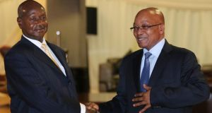 Ugandan president Yoweri Museveni (left) is welcomed by his South African counterpart, Jacob Zuma, at a meeting of leaders from the Southern African Development Community in Pretoria this week. Photograph: Siphiwe Sibeko/Reuters