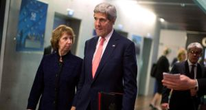 US secretary of state John Kerry walks with European Union foreign policy chief Catherine Ashton before their meeting with Iranian foreign minister Mohammad Javad Zari in Geneva yesterday. Photograph: Reuters/Jason Reed