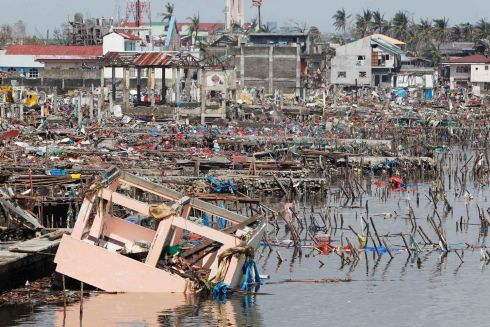 Debris from homes are pictured near the fishport after super Typhoon Haiyan battered Tacloban city, central Philippines. Photograph: Romeo Ranoco/Reuters