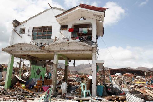 Survivors stay in their damaged house after super Typhoon Haiyan battered Tacloban city, central Philippines. Photograph: Romeo Ranoco/Reuters