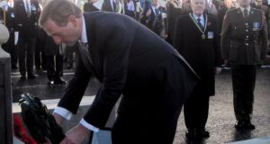 Taoiseach Enda Kenny lays a laurel wreath at the war memorial in Enniskillen, Co Fermanagh. Photograph: David Young/PA Wire