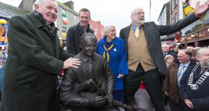 Piper Liam O'Flynn (left) with artist Shane Gilmore and American couple Judith and Barry Merrill who donated the statue at the unveiling in Miltown Malbay on Saturday. Photograph: Eamon Ward