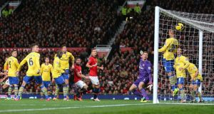 Manchester United's Robin van Persie (centre left)  scores with a header during the  Premier League game against Arsenal   at Old Trafford.  Photograph: Dave Thompson/PA Wire.