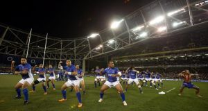 Brian Lima leads  the Siva Tau – Samoa's pre-game war dance – as a tribute to the recently passed Peter Fatialofa at the Aviva Stadium on Saturday. Photograph: Inpho