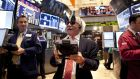 Wall Street traders wear 2013 new years party glasses: the four-day trading period between Christmas and the new year has seen average gains of 1.06 per cent since 1896 – 10 times that recorded by other four-day trading periods. photograph: allison joyce/getty images