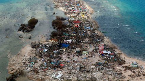 An aerial view of a coastal town devastated by typhoon Haiyan in the Philippines today. Photograph: Reuters