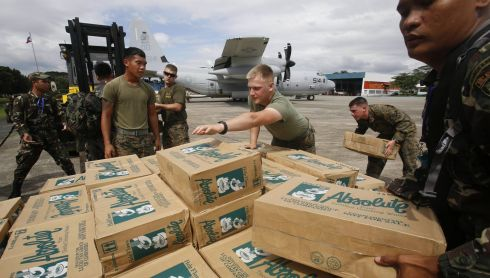 Philippine and US military personnel prepare to load relief goods on a USC-130 plane for victims of typhoon Haiyan at Villamor Air Base in Manila  today. Photograph: Reuters