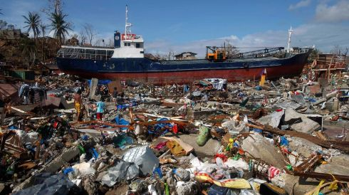 A cargo ship washed ashore is seen four days after super typhoon Haiyan hit Anibong town, Tacloban city, central Philippines  today. Photograph: Reuters