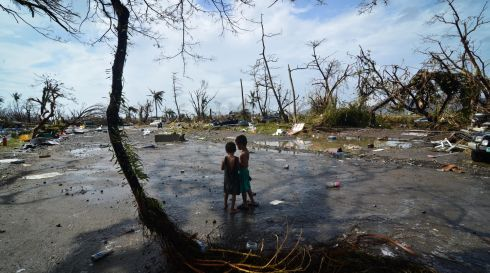Two young boys look at the devastation in the aftermath of the typhoon in Tacloban yesterday. Photograph: Getty Images