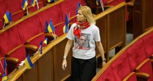 An opposition deputy, wearing a T-shirt in support of imprisoned former Ukrainian prime minister Yulia Tymoshenko, arrives at a session of parliament in Kiev. Photograph: Gleb Garanich/Reuters