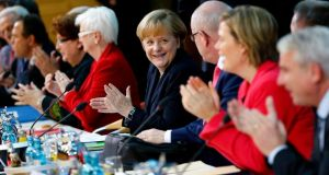 German chancellor Angela Merkel with colleagues in Berlin yesterday.  Photograph:  Tobias Schwarz/Reuters