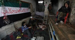 Free Syrian Army fighters resting in a safehouse in the Mouazafeen neighbourhood in Deir al-Zor, eastern Syria, earlier this week.  Photograph: Khalil Ashawi/Reuters