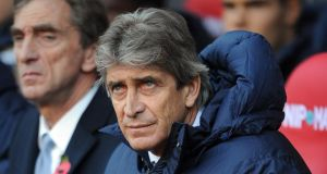 Manchester City manager Manuel Pellegrini: His side struggle on the road. Photograph: Chris Brunskill/Getty Images