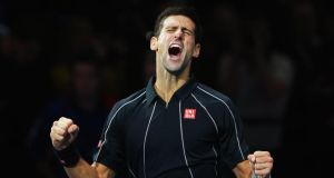 Novak Djokovic of Serbia celebrates victory over Rafael Nadal of Spain in last night's ATP World Tour Finals at the O2 Arena, London. Photograph: Clive Brunskill/Getty Images