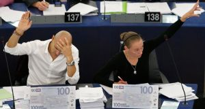 Members of the European Parliament Raul Romeva i Rueda (left) and Marije Cornelissen, from the Group of the Greens/European Free Alliance, vote on the European Budget during a the earlier stages of the debate last month. Photograph: Reuters