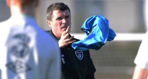 New Republic of Ireland assistant manager Roy Keane tosses out a training bib as he organises his first squad training session at Malhide yesterday. Photograph: Cyril Byrne/The Irish Times