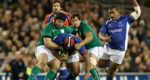 Ireland's Mike McCarthy and Mike Ross make one of the home side's 163 tackles against Samoa last week.  The visitors made 90 tackles. Photograph: Ryan Byrne/Inpho