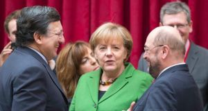 European Commission president Jose Manuel Barroso (left) speaks with German chancellor Angela Merkel (centre) and European Parliament president Martin Schultz (right) prior to an international summit on youth unemployment in the European Union at the Elysee Palace in Paris today. Photograph: Reuters