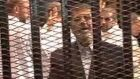 Ousted former Egyptian president Mohamed Morsi stands in a cage in a courthouse on the first day of his trial in Cairo last week. Photograph: Reuters