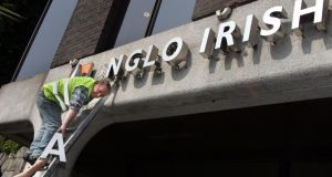 The Anglo Irish Bank signage is removed from the former bank premises at St Stephen's Green Dublin. Photograph: Matt Kavanagh /The Irish Times