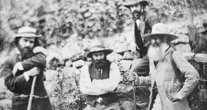 Cézanne (centre) and Camille Pissarro (far right)