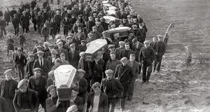 The funeral procession after the Árainn Mhór disaster of 1935, when 19 returning migrant labourers died after their boat hit rocks