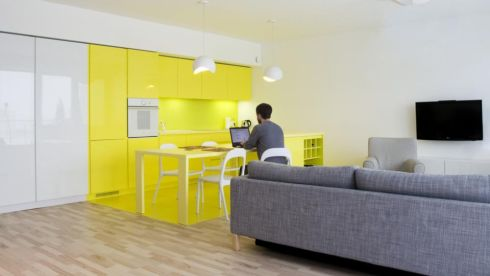 SMALL BUT CHIC A really cool way to update grey from Polish architecture firm Pera Studio is to mix the now ubiquitous grey with blocks of modern colour. Grey with white and neon yellow makes this small open-plan space feel bigger. Krakow-based Pera carries the yellow through the kitchen cabinets and floor. Alan Gallagher (046-955 2635/ 087-2265362) of Gallagher Interiors does a lot of work for Boyd Cody Architects. perastudio.pl, boydcodyarch.com