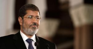 "Former  president Mohammed Morsi: ""This coup will fall by the strength of the Egyptian people and their fight for rights and freedom.""  Photograph: Maya Alleruzzo/AP"
