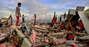 Residents gather In Tacloban amidst the devastation icaused by Typhoon Haiyan