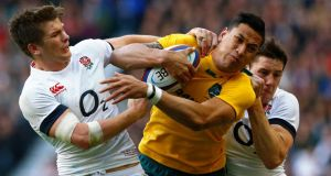 England's Joel Tomkins (right) and Owen Farrell  tackle Australia's Israel Folau at Twickenham earlier this month. Photograph: Reuters