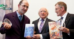 President Michael D Higgins  with Micheál Ó Conghaile, one of the editors of Leabhar Mór na nAmhrán, and  Colm  Ó Raghallaigh, who published the graphic novel version of Gráinne Mhaol. Photograph: Johnny Bambury