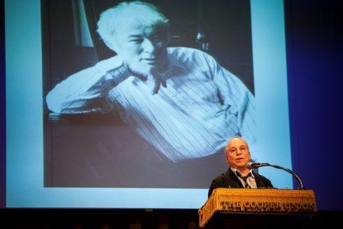 Veteran musician Paul Simon reads a poem during a tribute to poet Seamus Heaney at Cooper Union in New York City.  Photograph: Michael Nagle