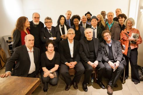 Poets, novelists and musicians gather backstage before the New York tribute to Seamus Heaney at Cooper Union. Photograph: Michael Nagle