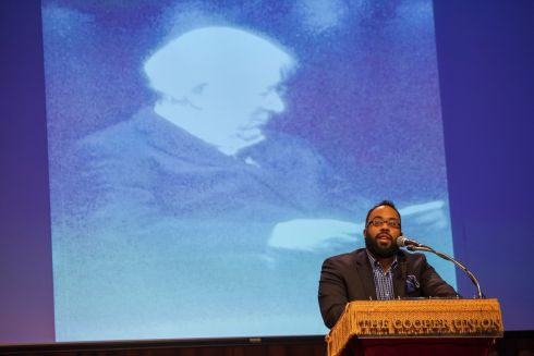 Kevin Young reads a poem in honour of Heaney. Photograph: Michael Nagle