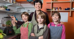 Fionnuala McKenna, of the Purple Root Cafe, Westport, serving up raw vegan food and beverages with her twin sons, Calum (left) and Luke (right), and daughter Roadhán. Photographs: Michael McLaughlin