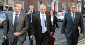 Members of the Troika arriving at Government Buildings in April 2012. Photograph: Dara Mac Dónaill