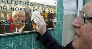Eddie McGrady photographed wiping clean the election office plaque, after handing in his nomination papers for South Down in 2005. Photograph: Paul Faith/PA Wire