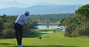 Simon Wakefield of England plays a tee shot during the fifth round of European Tour qualifying school final stage at PGA Catalunya . Photograph: Stuart Franklin/Getty Images